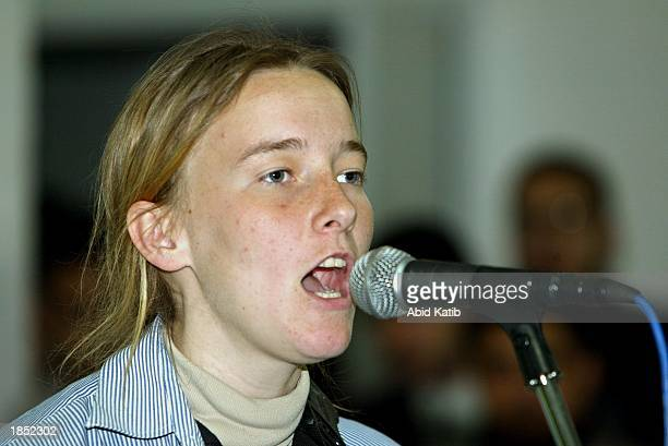 American peace activist Rachel Corrie speaks during a mock trial of US President George W Bush March 5 2003 in Rafah refugee camp in the Gaza Strip...