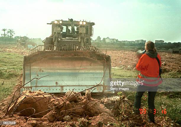 American peace activist Rachel Corrie tries to stop an Israeli bulldozer from destroying Palestinian land March 16 2003 in the Rafah refugee camp in...