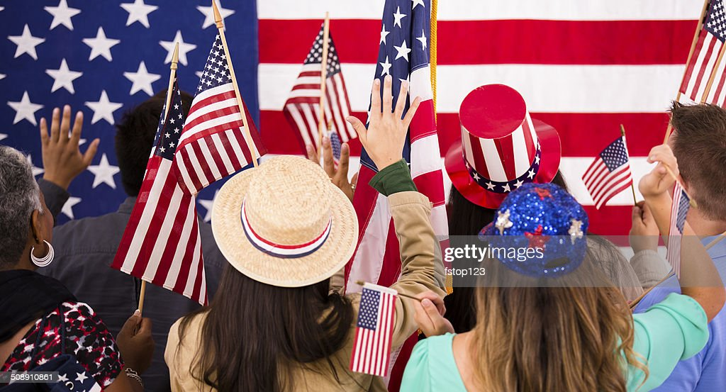 American people wave flags at political rally. USA. : Stock Photo