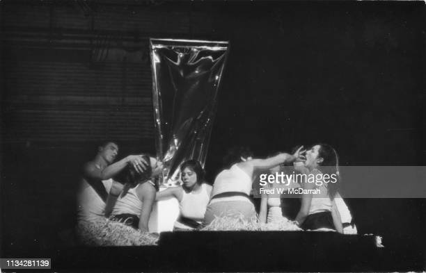 American performance and visual artist Carolee Schneemann and unidentified others perform at an unspecified Happening New York New York March 8 1968