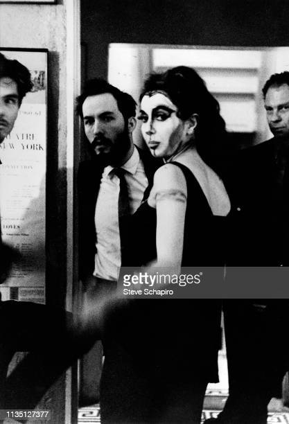 American performance and visual artist Carolee Schneemann in costume stands composer James Tenney and dancer choreographer Merce Cunningham in a...