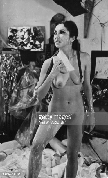 American performance and visual artist Carolee Schneemann performs her piece 'Body Collage' at the Kinetic Theater New York New York December 20 1967