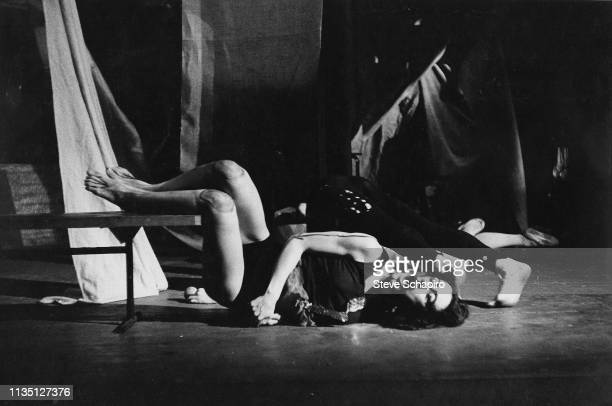 American performance and visual artist Carolee Schneemann performs with unidentified others during an unspecified Happening New York 1964