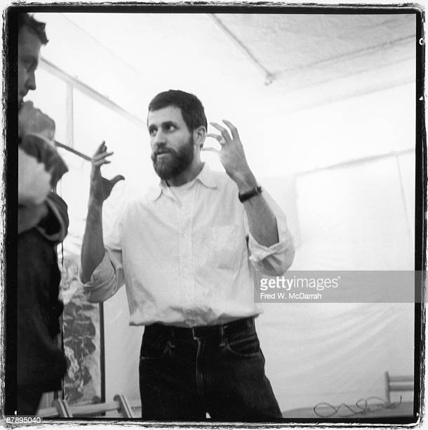 American performance artist Allan Kaprow speaks with unidentified fellow performers as he rehearses his '18 Happenings in 6 Parts' exhibition at the...