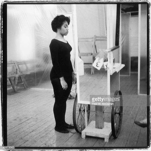 American performance artist Shirley Prendergast stands next to the 'Sandwich Man' a wheeled sculpture with a mirror body paint can head and...