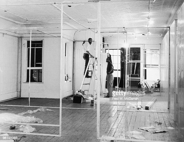 American performance artists Allan Kaprow and Robert Whitman set up an exhibition at the Ruben Gallery New York New York August 5 1959 The exhibition...