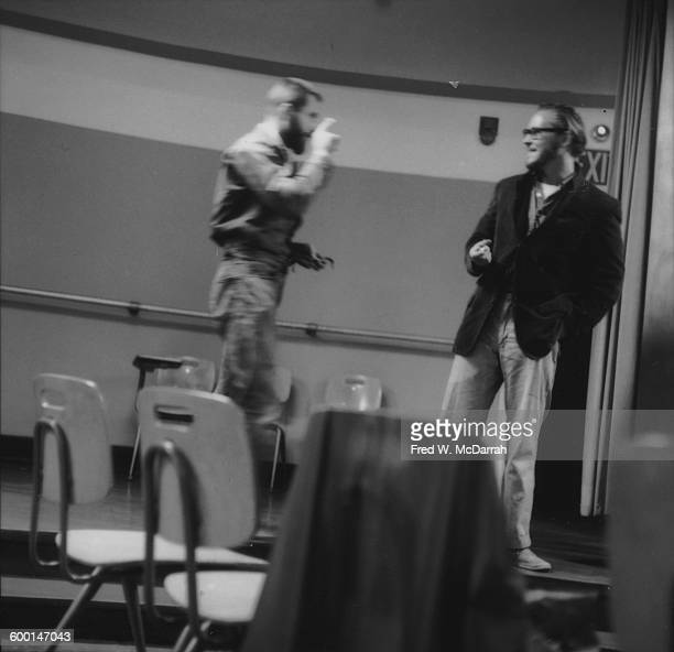 American performance artists Allan Kaprow and Robert Whitman speak together in a classroom at the New School New York New York August 5 1959 At the...