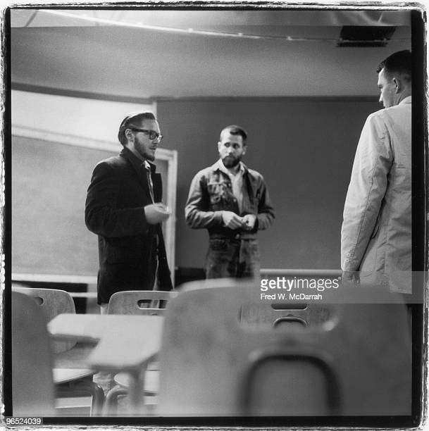 American performance artists Robert Whitman and Allan Kaprow speak with artist and composer George Brecht in a classroom at the New School New York...