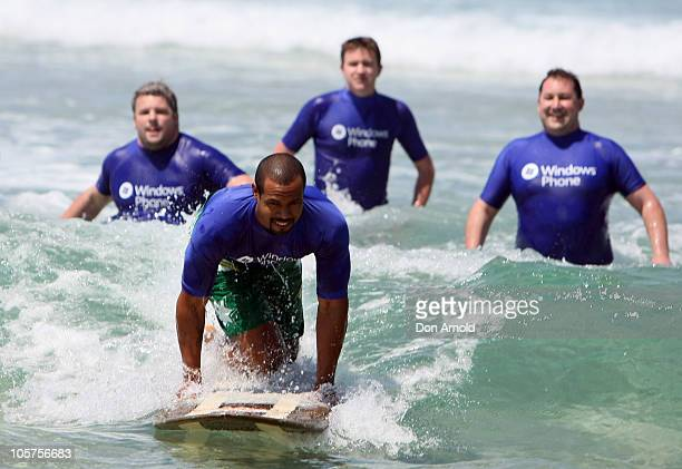 American personality Isaiah Mustafa of Old Spice commercial fame has a surfing lesson at Bondi Beach on October 20 2010 in Sydney Australia