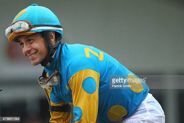 American Pharoah ridden by Victor Espinoza acknowledges the crowd after winning the 140th running of the Preakness Stakes at Pimlico Race Course on...