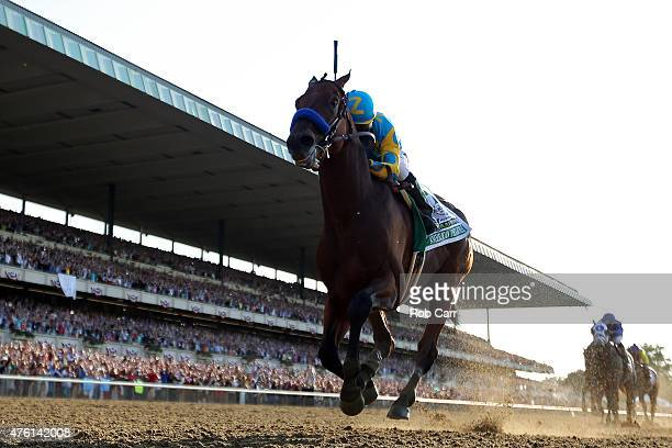 American Pharoah ridden by Victor Espinoza comes down the final stretch ahead of the field on his way to winning the 147th running of the Belmont...