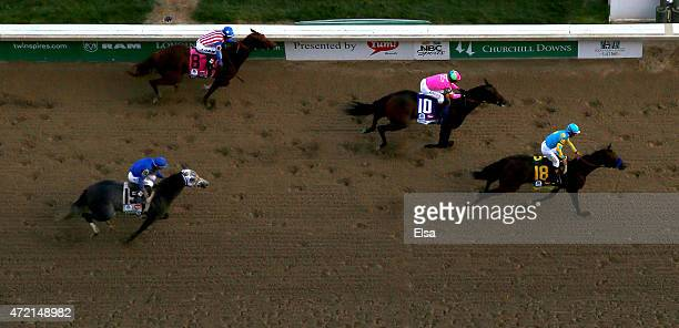 American Pharoah ridden by Victor Espinoza crosses the finish line to win the 141st running of the Kentucky Derby at Churchill Downs on May 2 2015 in...