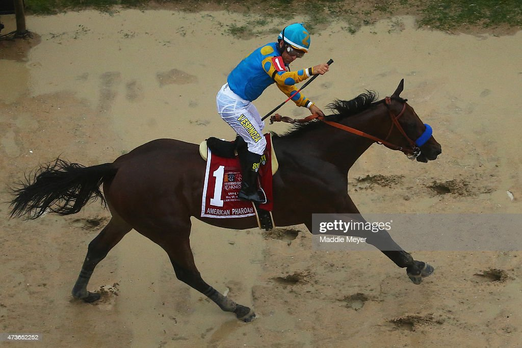 American Pharoah ridden by Victor Espinoza crosses the finish line to win the 140th running of the Preakness Stakes at Pimlico Race Course on May 16, 2015 in Baltimore, Maryland.