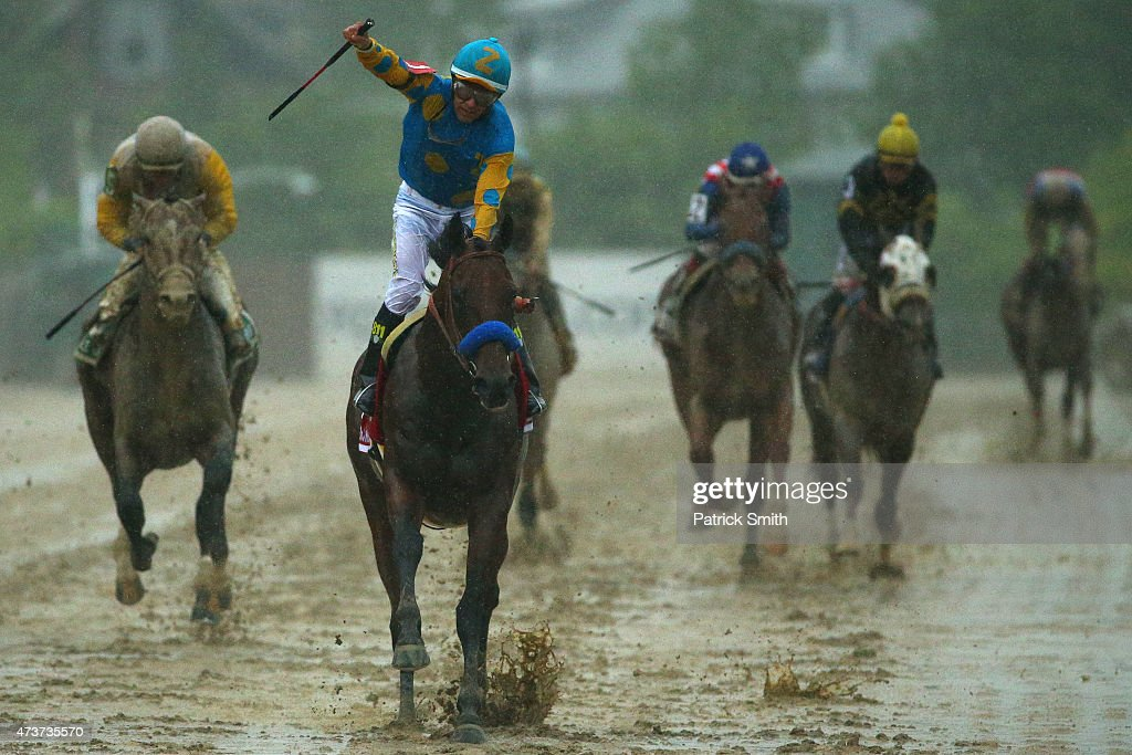 American Pharoah #1 ridden by Victor Espinoza crosses the finish line to win the 140th running of the Preakness Stakes at Pimlico Race Course on May 16, 2015 in Baltimore, Maryland.