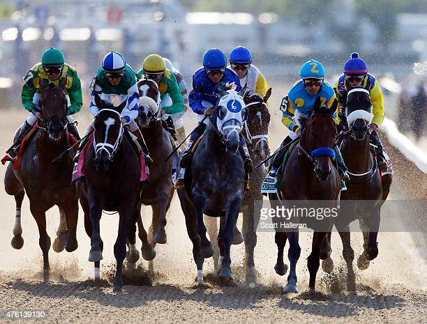 American Pharoah ridden by Victor Espinoza during the 147th running of the Belmont Stakes at Belmont Park on June 6 2015 in Elmont New York