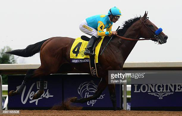 American Pharoah ridden by Victor Espinoza leads the field during the Breeders' Cup Classic during day two of the Breeders' Cup at Keeneland...