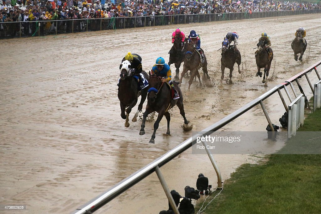 American Pharoah #1 ridden by Victor Espinoza leads the field into the first turn during the 140th running of the Preakness Stakes at Pimlico Race Course on May 16, 2015 in Baltimore, Maryland.