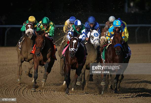 American Pharoah ridden by Victor Espinoza leads the pack during the 147th running of the Belmont Stakes at Belmont Park on June 6 2015 in Elmont New...