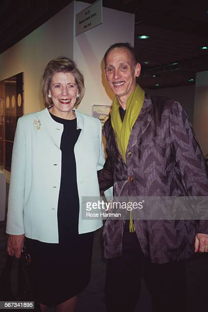American philanthropist art patron and collector Agnes Gund with American film director John Waters at an art fare circa 2006