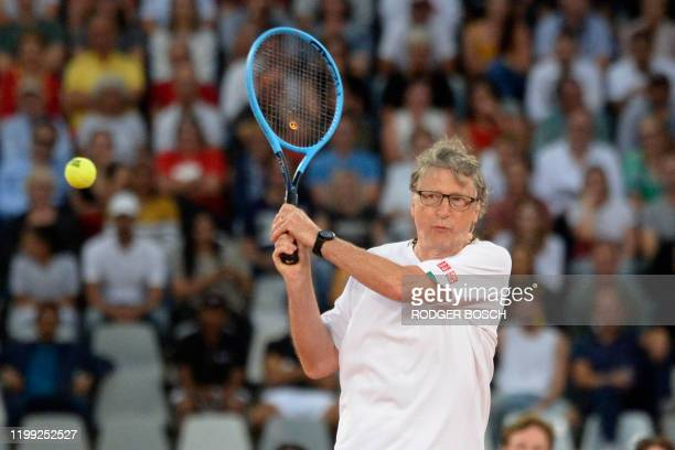 American philanthropist Bill Gates plays a return to Spain's Rafael Nadal and South African Comedian Trevor Noah during their double's tennis match...