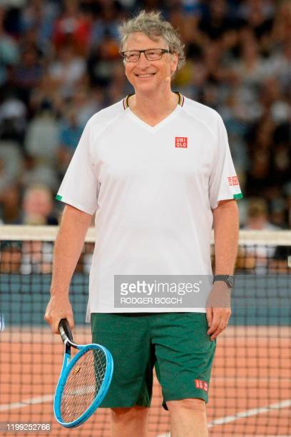 American philanthropist Bill Gates reacts after a point against Spain's Rafael Nadal and South African Comedian Trevor Noah during their double's...