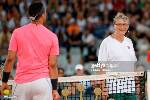 American philanthropist Bill Gates reacts towards South African Comedian Trevor Noah during their double's tennis match at The Match in Africa at the...