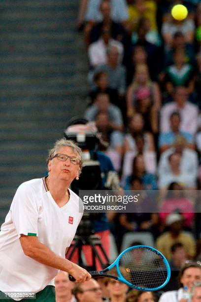 American philanthropist Bill Gates serves to Spain's Rafael Nadal and South African Comedian Trevor Noah during their double's tennis match at The...
