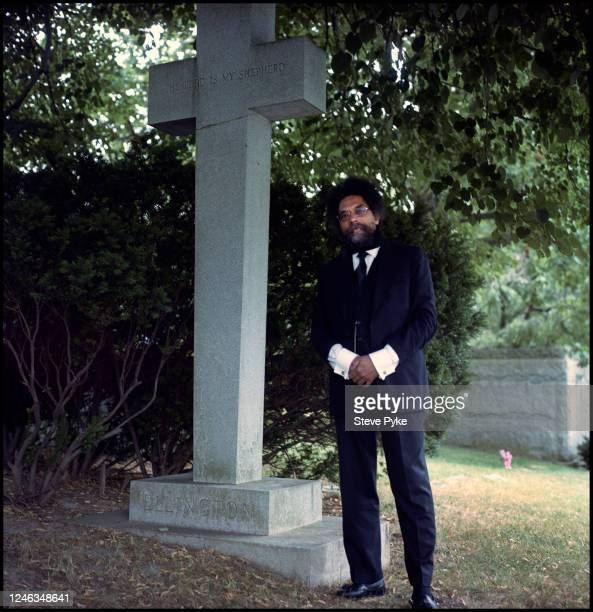 American philosopher and political activist Cornel West standing by the grave of jazz musician Duke Ellington at Woodlawn Cemetery New York City 24th...