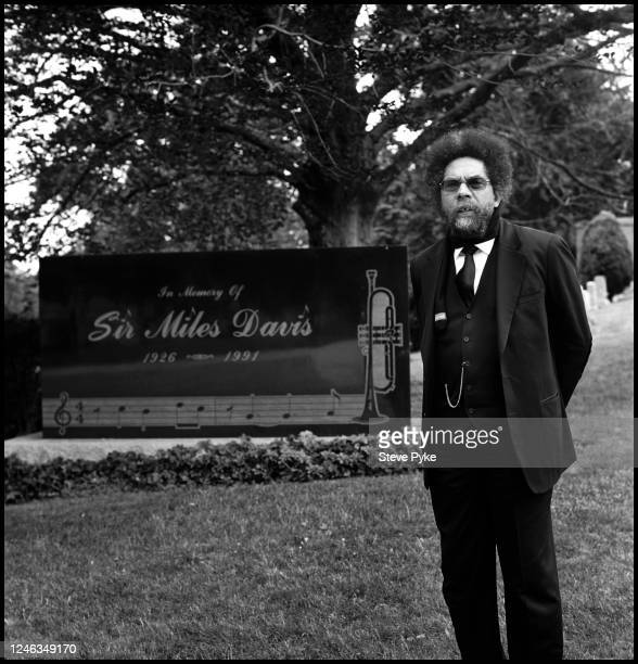 American philosopher and political activist Cornel West standing by the grave of jazz musician Miles Davis at Woodlawn Cemetery New York City 24th...