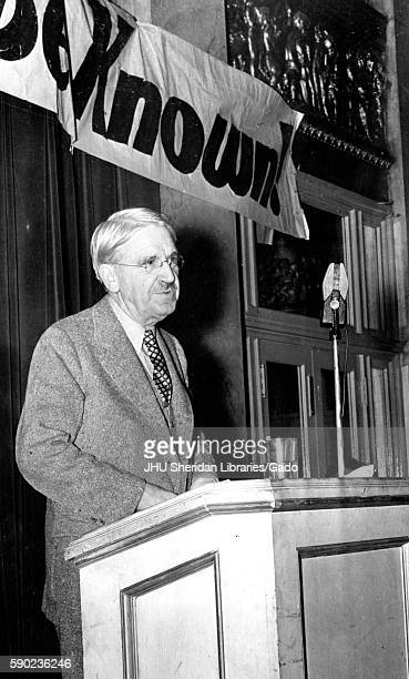 American philosopher psychologist and educational reformer John Dewey stands at a podium presenting Trotsky Commission findings 1937