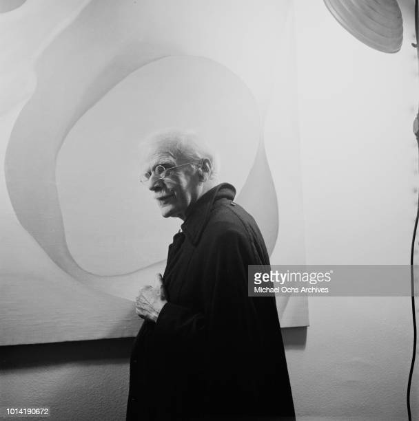 American photographer Alfred Stieglitz in New York City with a painting by his wife artist Georgia O'Keeffe circa 1944