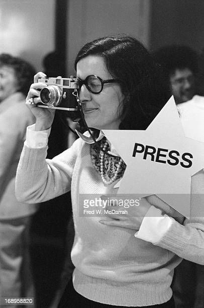 American photographer and author Jill Krementz looks through camera lens as she attends an exhibit in Soho New York New York November 21 1974 She...