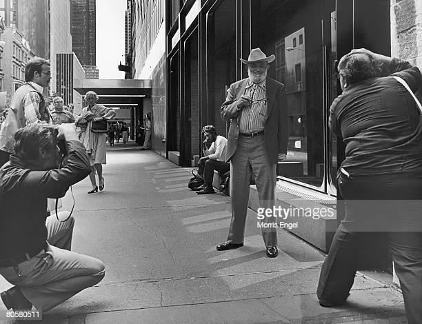 American photographer Ansel Adams poses for photographers on a Manhattan sidewalk New York New York late 1970s