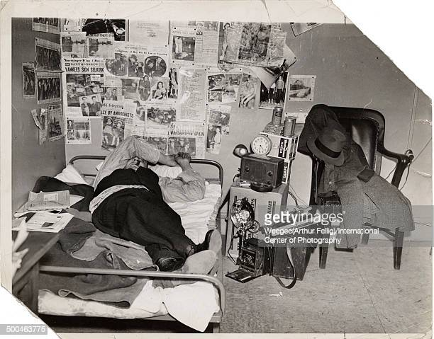 American photographer Arthur Fellig better known as Weegee lies on his bed an arm over his eyes and a cigar in his mouth in a photograph entitled 'My...
