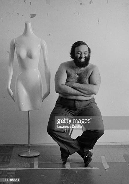 American photographer Lawrence Schiller laughs as he poses shirtless for a portrait Des Moines Iowa 1974 The picture was taken by British...