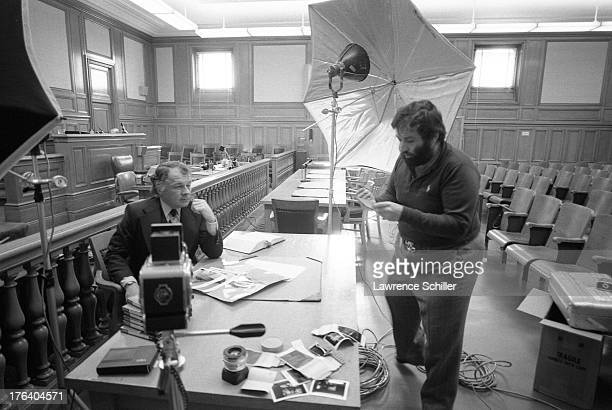 American photographer Lawrence Schiller takes a photo of attorney F Lee Bailey in a courtroom San Francisco California 1976 At the time Bailey was...