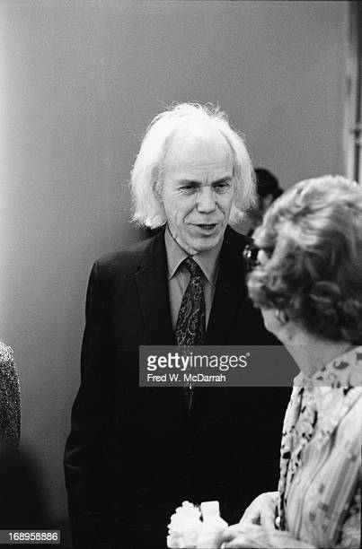 American photographer Minor White speaks with Museum of Modern Art curator Grace Mayer at a photography exhibition New York New York January 27 1975