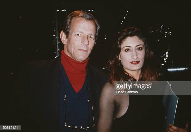 American photographer Peter Beard with his wife Nejma Beard at a private party circa 1994