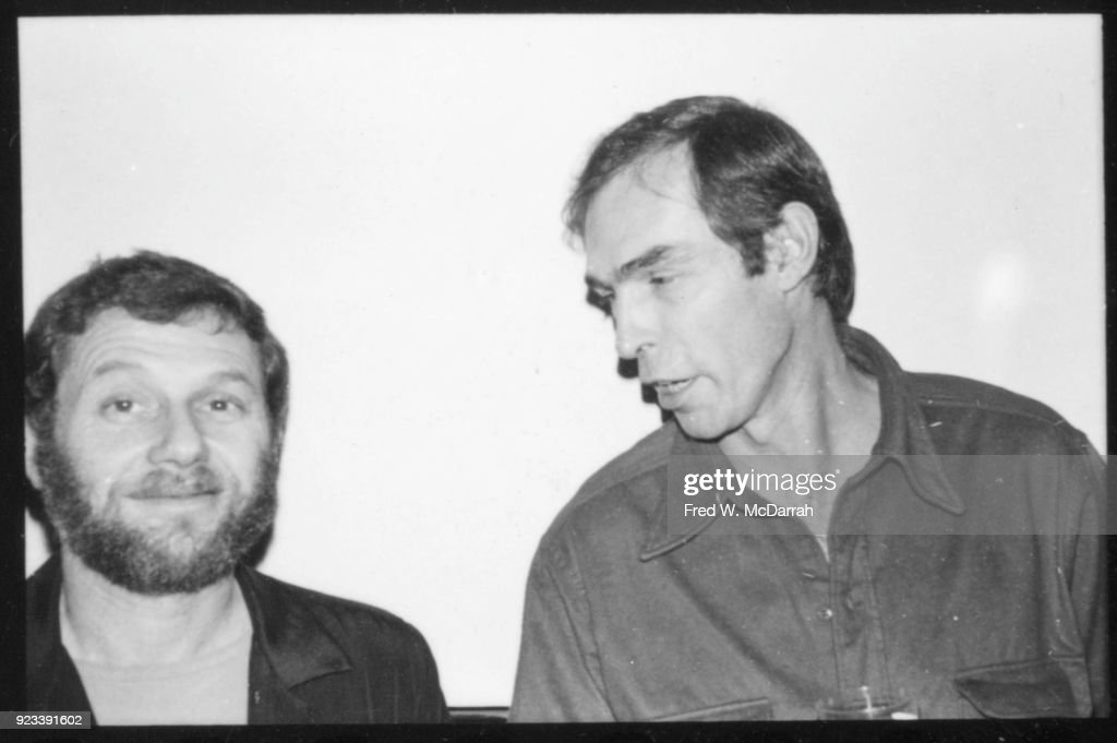 American photographer Peter Hujar (1934 - 1987) (right) leans over to speak with unidentified man at a Village Voice Christmas party, New York, New York, December 8, 1978.