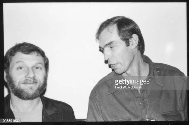 American photographer Peter Hujar leans over to speak with unidentified man at a Village Voice Christmas party New York New York December 8 1978