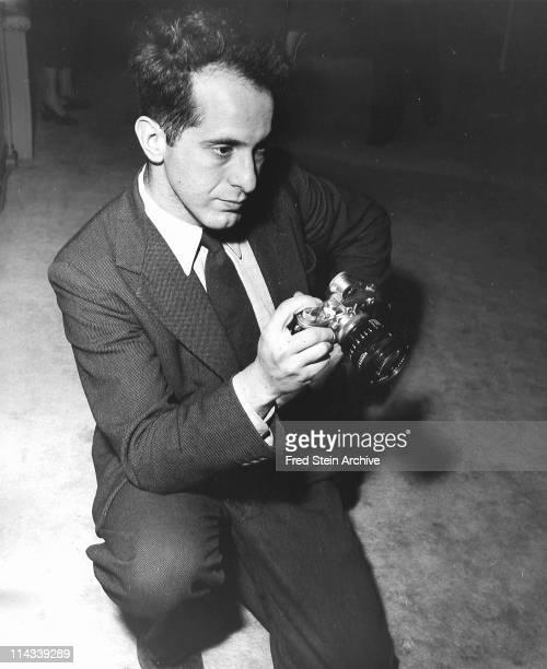 American photographer Robert Frank holding a prewar Leica camera 1954
