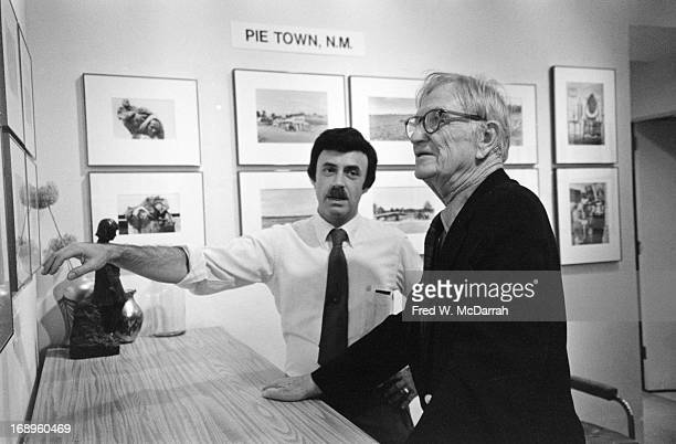 American photographer Russell Lee reviews an exhibit of his work with gallery owner Lee D Witkin New York New York September 11 1982 The exhibit...