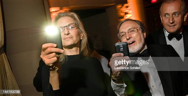 American photographers Annie Leibovitz and Lawrence Schiller compare their smartphone cameras at the Norman Mailer Center Benefit Gala New York New...