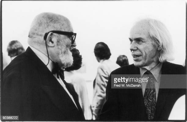 American photographers Ansel Adams and Minor White talk at an Edward Weston exhibition at the Museum of Modern Art New York New York January 27 1975