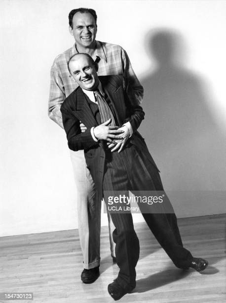 American photographers Ansel Adams and Willard Morgan clown about in a photo studio Scarsdale New York 1942 The studio belonged to Barbara Morgan who...
