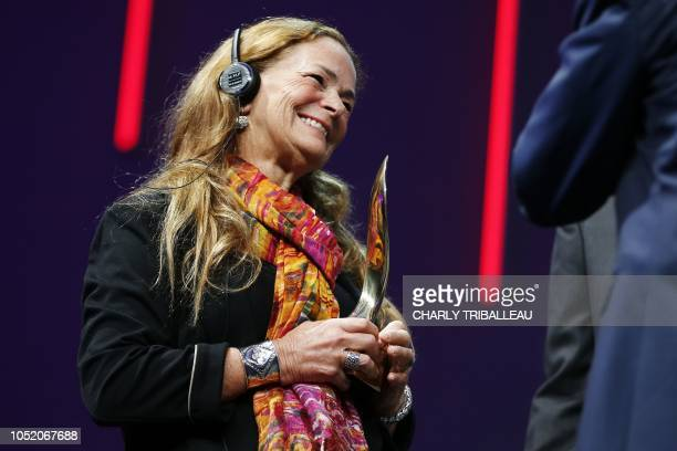 American photojournalist Paula Bronstein smiles as she receives the Prix du public award for her work The Rohingya crisis a harrowing journey...