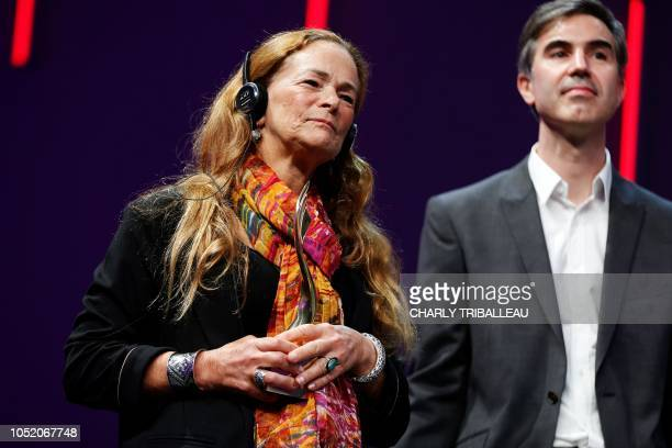 American photojournalist Paula Bronstein stands as she receives the Prix du public award for her work The Rohingya crisis a harrowing journey...