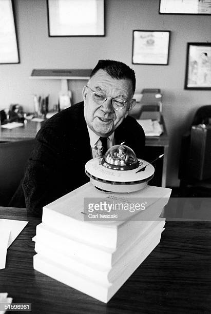 American physicist Edward U Condon discusses UFOs at the University of Colorado at Boulder Boulder Colorado January 1969 A toy flying saucer sits on...