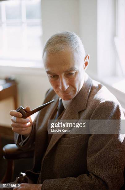 Physicist J Robert Oppenheimer smoking a pipe in his office Oppenheimer is known as the Father of the Atomic Bomb and was head of the Manhattan...