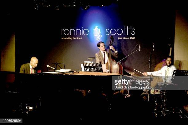 American pianist Aaron Diehl performs live on stage with his trio at Ronnie Scott's Jazz Club in Soho London on 22nd August 2011